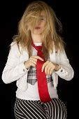 picture of tied hair  - Female model straightening tie with messy hair - JPG