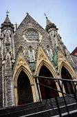 image of upstairs  - Catholic church Gothic facade with entrance upstairs and stone walls wide angle - JPG
