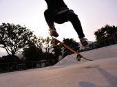 stock photo of skateboarding  - skateboarder riding on skateboard at skate park - JPG