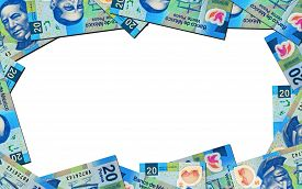 image of pesos  - Twenty peso bills creating a picture frame - JPG