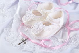 stock photo of christening  - Baby shoe and cross for Christening - JPG