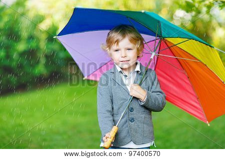 Little Cute Toddler Boy With Colorful Umbrella And Boots, Outdoors