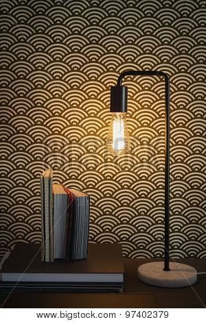 Edison filament table lamp and books