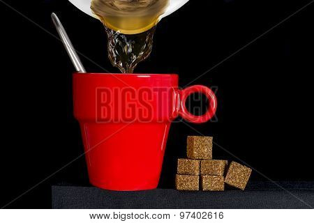 Coffee Pot Filling A Red Cup