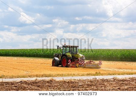 Agriculture - Tractor Ploughing At The Field