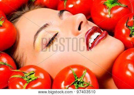 Close-up portrait of a beautiful smiling woman among the tomato. Healthy eating concept. Make-up, cosmetics.