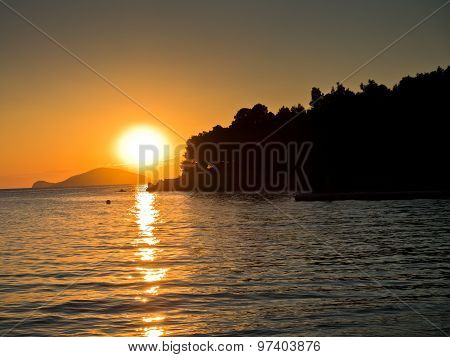 Sunset with small pier and turtle island in background,Sithonia