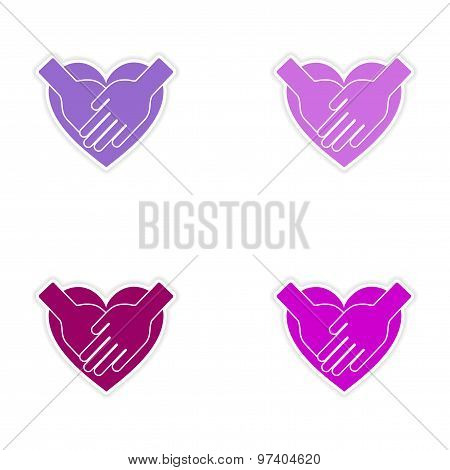 assembly realistic sticker design on paper hands heart