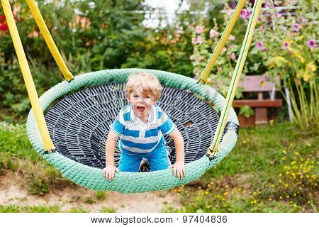 Adorable Toddler Boy Having Fun Chain Swing On Outdoor Playground