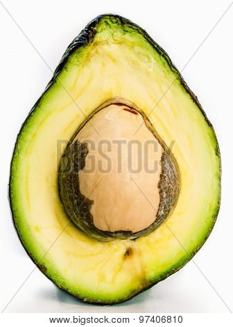 Halved Avocado With Core Isolated On White - In Macro Shot.