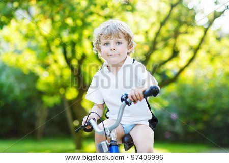 Little Preschool Kid Boy Riding With Bicycle In Summer