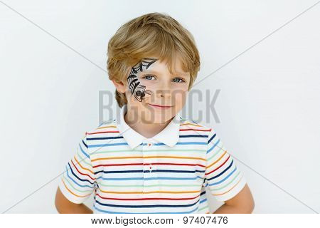 Little Kid Boy With Face Painted With A Spider Web