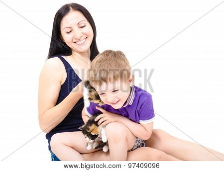 Happy  mother and son together with kittens