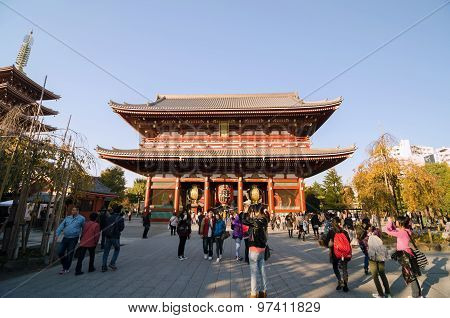 Tokyo, Japan - November 21, 2013: Tourists Visit Buddhist Temple Senso-ji In Tokyo