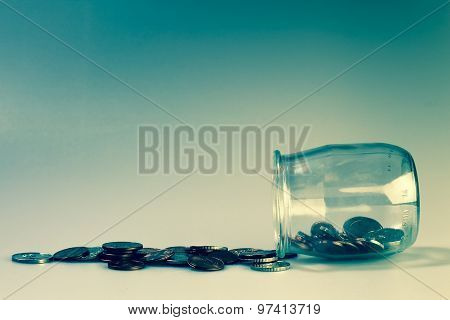 Money And Banking Concept With Coins And Jar.