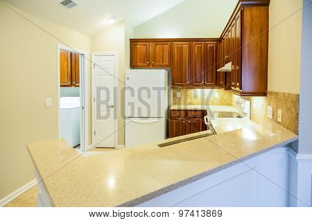Grainite Countertops In Bright New Kitchen