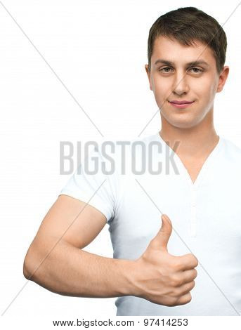 Young Man Shows Thumb Up Gesture.