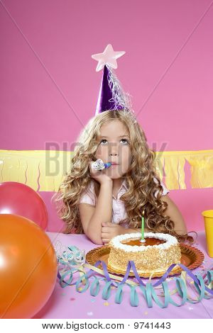 Bored Little Blond Girl Birthday Party With Candle Cake