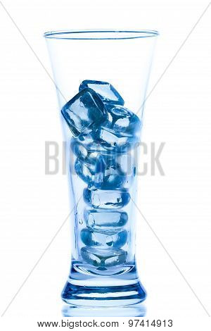 Elegant Tall Glass With Ice And Water Drops On White Background