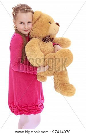 Pretty girl holding bear