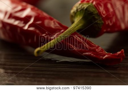 Red Chili Pepper On A Dark Background With Water Drops, Macro