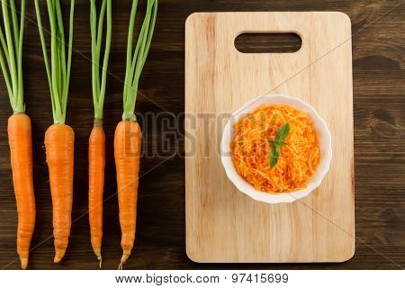 Bunch Of Fresh Carrots With Green Leaves On Wooden . Cooking Carrot Salad. Healthy Vegetarian Food