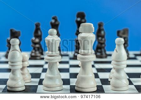 Chess Set With White And Black Wooden Pieces.