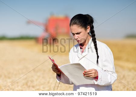 Woman Agronomist In Wheat Field