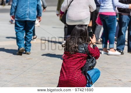 Young Woman Taking A Photo