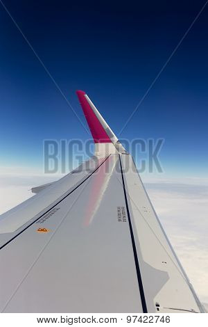 Airplane Window Seat View Over Wing Whilst Flying