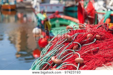 Colorful Fishing Net Laying On A Pier