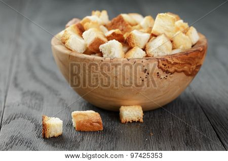 homemade croutons from white bread in wood bowl