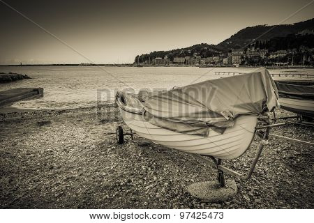 Boat Docked On A Beach, Black And White Vintage Style Photo.