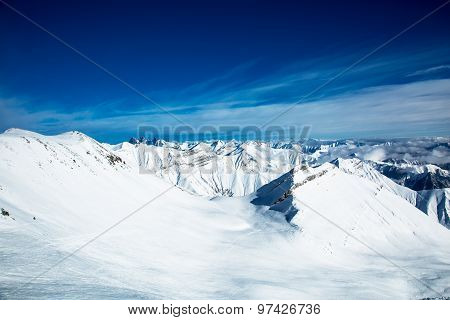 Buachaille Etive Mor mountain and a snow covered winter landscape in the Scottish highlands.
