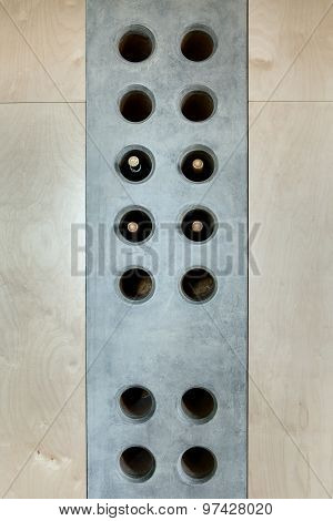 Several bottles of wine in a special concrete hole