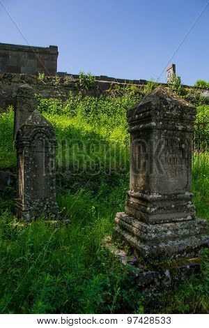 Old Gravestones Become Overgrown With Grass