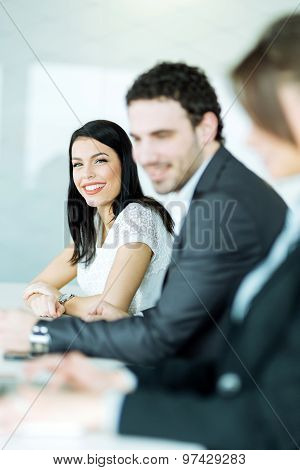 Business People Sitting At A Conference Table