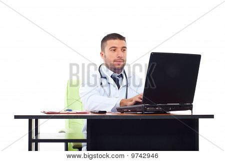 Doctor Man Typing On Laptop In Office