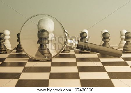 Strategic Planning, Intelligence Concept Photo With Chess Pawns And Magnifier, Retro Sepia Colors.