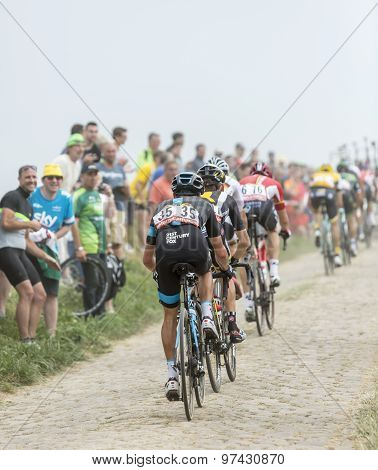 The Peloton On A Cobblestoned Road - Tour De France 2015