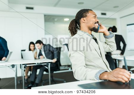 Black Handsome Graphics Designer  With Dreadlocks Using Digitizer In A Well Lit, Tidy Office Environ
