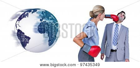 Businesswoman punching colleague with boxing gloves against black and white earth