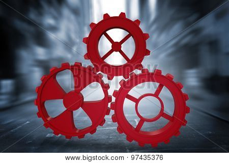 Red cog and wheel against blurry new york street