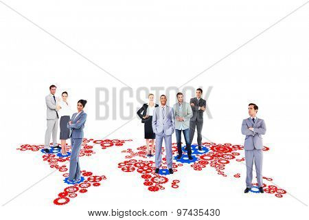 Business team against map made of cogs and wheels