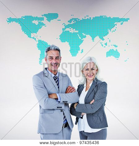 Smiling businesswoman and man with arms crossed against green world map on white background
