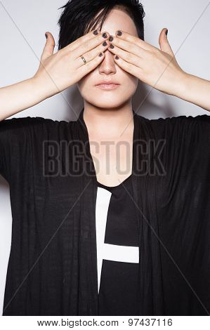 Girl in a black dress with shaved head, art gothic style.