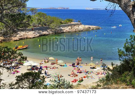 SAN ANTONIO, SPAIN - JUNE 18: Sunbathers at Cala Gracio beach on June 18, 2015, in San Antonio, in Ibiza Island, Spain. Ibiza is a well-known summer tourist destination in Europe