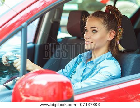 Young Smiling Woman Driving The Car