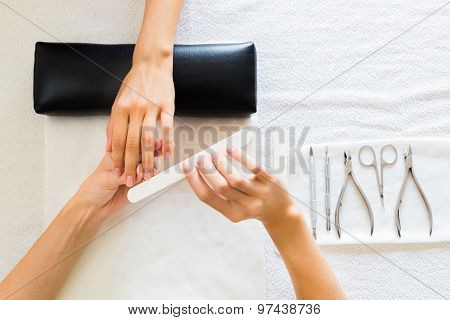 Lady receiving a manicure in salon