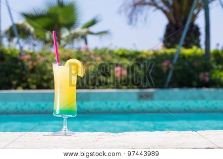 Glass Of Happy Days Cocktail Near The Pool